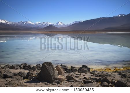 Lake Blanca during salar de uyuni tour, altiplano with snowy mountains background
