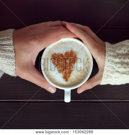 couple people transmitting cappuccino with a heart to each other / recognition ardent love