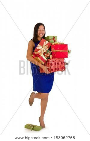 Attractive young woman holding too many Christmas presents