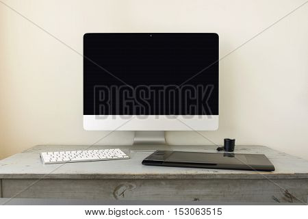 Computer With Keyboard And Graphic Tablet On Wooden Table And Space For Copy