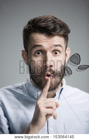 Man Is Looking Wary. Over Gray Background