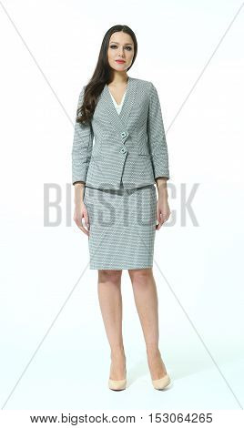 woman with straight hair style in office skirt suit power dress high heels shoes full length body portrait standing isolated on white