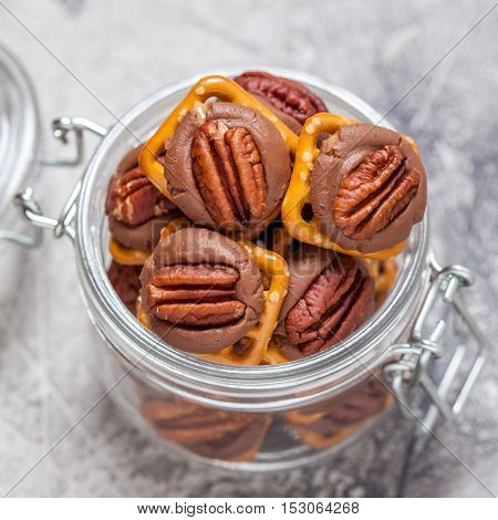 Chocolate Caramel Pecan Pretzel Bites in a jar