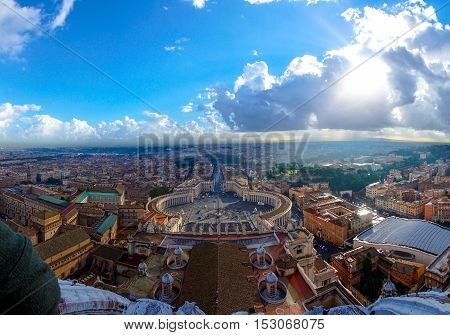 St. Peter's Square of the historical landmark plaza on cloudy blue sky with the panorama view of rome city town, Vatican, Rome Italy