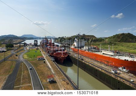 Panama Canal Panama - March 17 2014: A cargo ship and a oil tanker in the Miraflores Locks in the Panama Canal in Panama