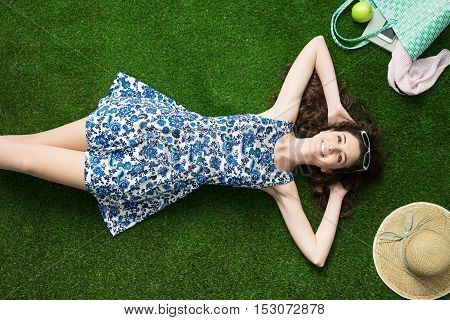 Happy Woman Relaxing On The Grass