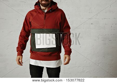 Man In Red Anorak With White Sheet Of Paper