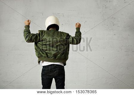 Man In A Khaki Pilot Jacket With Helmet