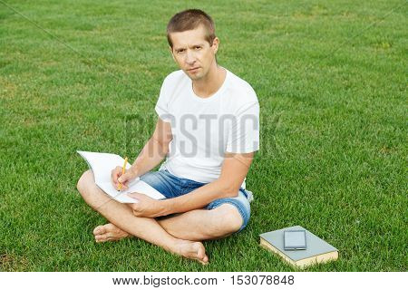 The Young Man Writes To A Notebook