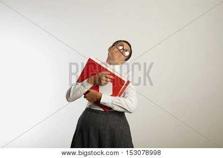 Overwhelmed Teacher With Heavy Binders