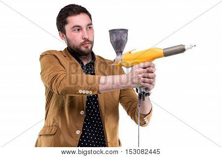 Young bearded man with powder gun on white background