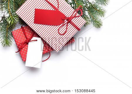 Christmas gift boxes and fir tree. Isolated on white background. Top view