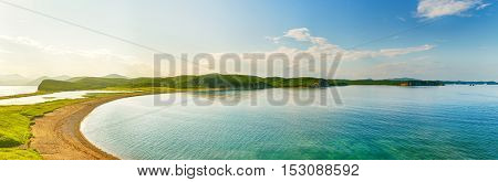 Amazing landscape at sunset. Coastal view of Far East. Russia.. Panorama