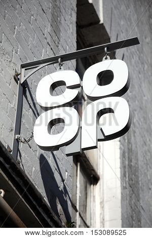 Carmarthen, UK, October 22, 2016 :  Co Op logo advertising sign outside one of its its retail supermarket stores in the city centre