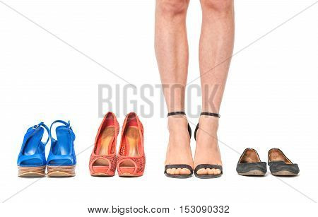 Closeup Of Woman Choosing A Pair Of Shoes - Isolated On White.