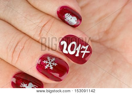 Finger nail with christmas pattern isolated on white background