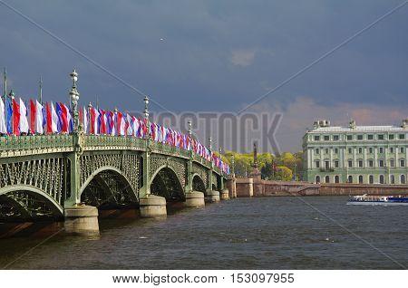 SAINT PETERSBURG RUSSIA - MAY10 2014: the Bascule Trinity Bridge Troitsky bridge across the Neva river with tricolor flags