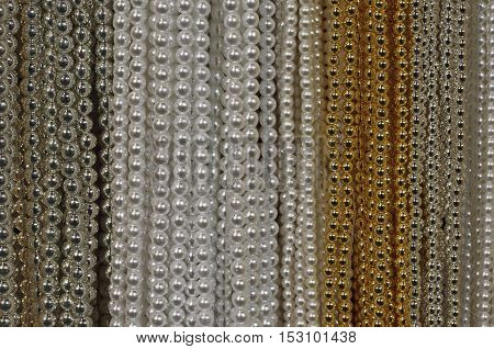 Background Of Precious Necklaces Of Gold Beads Silver And White