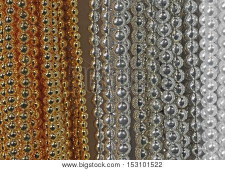 Background Of Precious Necklaces Of Gold Beads Silver