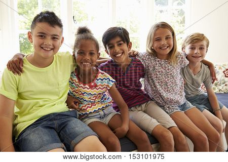 Group Of Multi-Cultural Children On Window Seat Together
