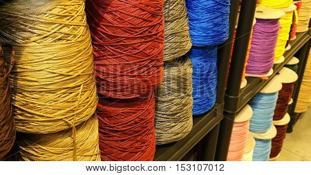 Shelf Full Of Skeins Of Colored Threads Of Wool And Cotton For S