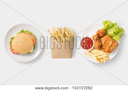 Concept Of Mock Up Burger, French Fries And Fried Chicken Set Isolated On White Background. Copy Spa