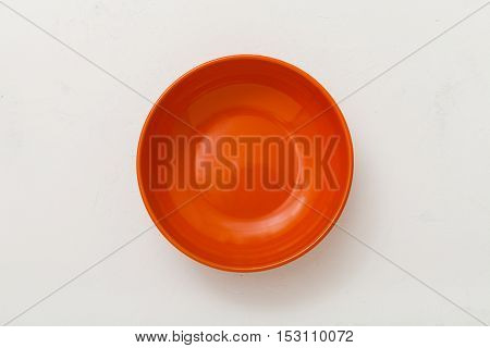 Top View Of Orange Bowl On Plastering Plate
