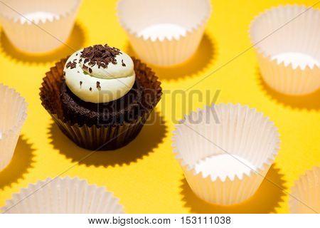 Birthday cupcake against a yellow background. Sweet dessert.  Sweet cupcake. Homemade cupcake.