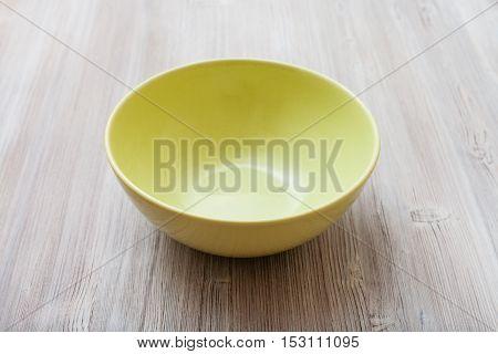Green Bowl On Gray Brown Board