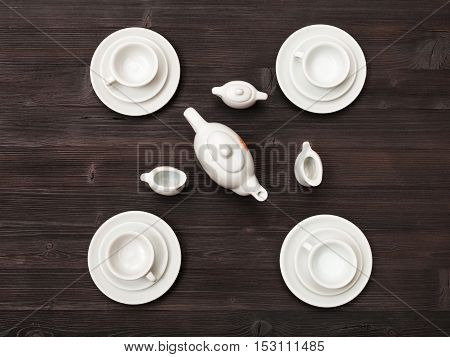 Top View Of Tea Set On Dark Brown Table
