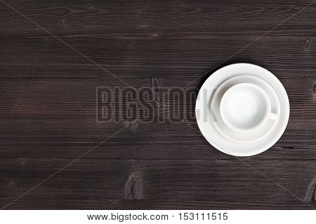 Above View Of Cup With Saucers On Dark Brown Table
