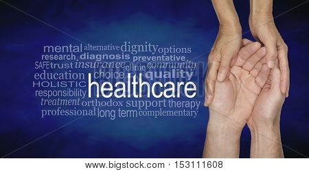 Health Care Word Cloud - female hands gently cradling male hands on a misty blue vignette background with a healthcare word cloud to the left