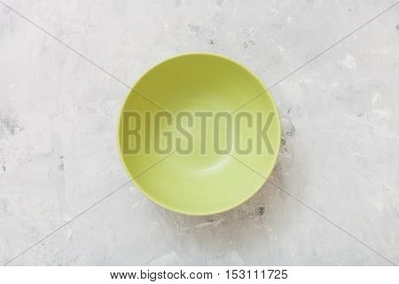 Top View Of Green Bowl On Concrete Plate