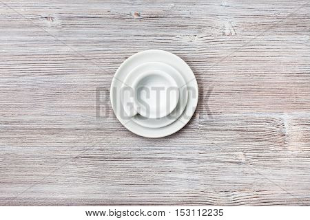 Above View Of Cup With Saucers On Gray Brown Table