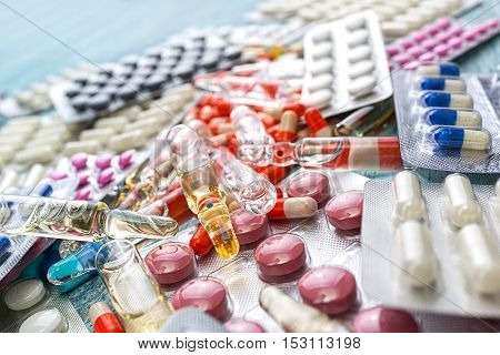 Drug ampules prescription for treatment medication. Pharmacy theme, Pharmaceutical medicament for health. Heap of red orange white round capsule in stick pills with medicine antibiotic in packages