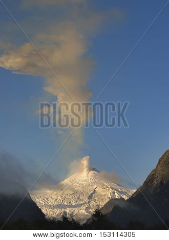 Golden light on active volcano Villarrica with snowy summit, Pucon, Chile