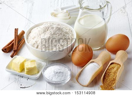 Ingredients for baking cake (flour, butter, eggs, sugar, cinnamon)