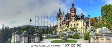 Beautiful panorama with famous and medieval Peles castle in autumn season Sinaia Romania
