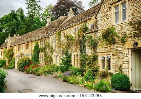 Historic stone built cottages with small gardens in the medieval village of Castle Combe, Wiltshire, England.