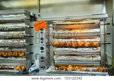 Roasting Chickens On A Rotisserie At A Market