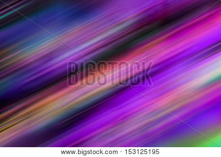 Multi colored abstract motion blur image creating smooth straight diagonal lines of purple pink and blue. Ideal for background use with copy space.
