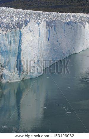 Perfect reflection Perito Moreno in the glacier lake