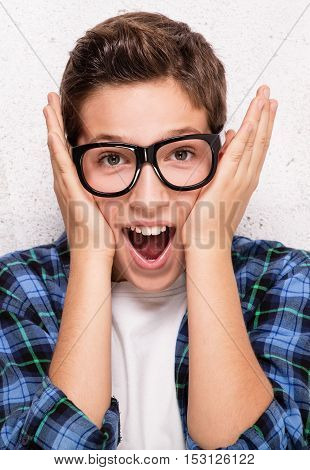 Portrait Of Surprised Young Boy.