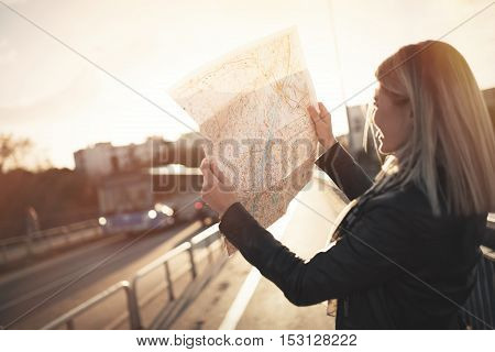 Tourist woman holding travelers map to travel to destination