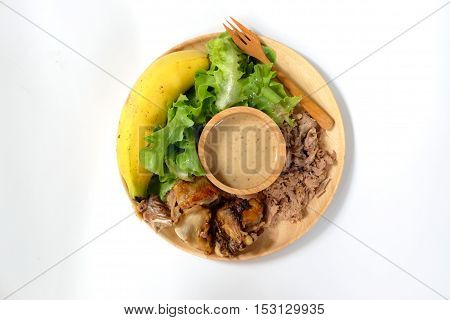 Homemade healthy food vegetable tunachicken and banana on wood dish
