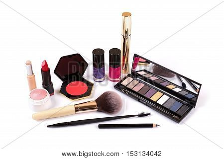 collection of makeup cosmetics isolated on white