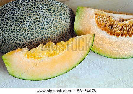 Melon Or Cantaloupe Sliced On Wooden Board With Seeds (also Called As Cantelope, Cantaloup, Muskmelo