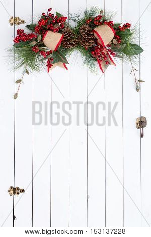 White Barn Door With Rustic Christmas Decoration