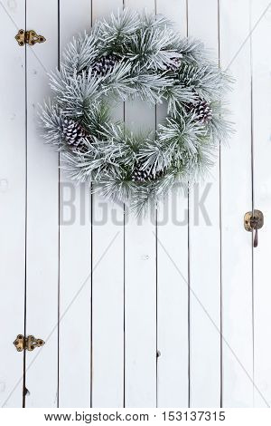 Snowy Winter Christmas Wreath On A Barn Door