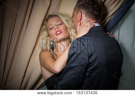 Passionate man leaning in to kiss womans neck